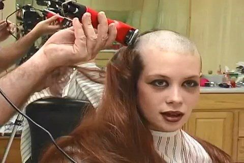 Woman has head shaved by barber