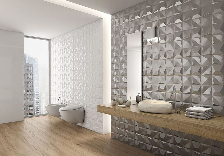 Bathroom Tile Idea - Install 3D Tiles To Add Texture To Your Bathroom | The metallic tiles on one of these bathroom walls give the bathroom a glamorous feel while the white 3D tiles add a more subtle texture to the walls.