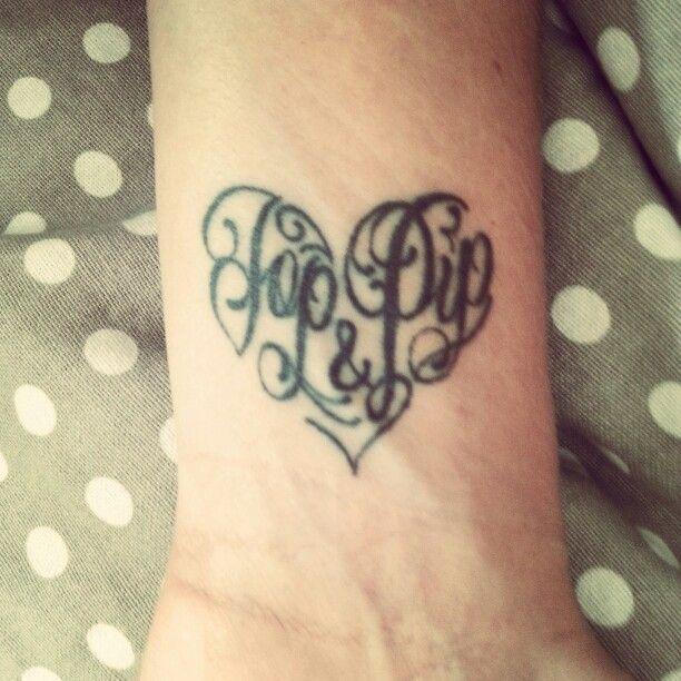 Tatoeage hart met namen van kindjes erin