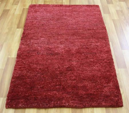 Emphasize your floor with this Red Knotted Hemp Rug.