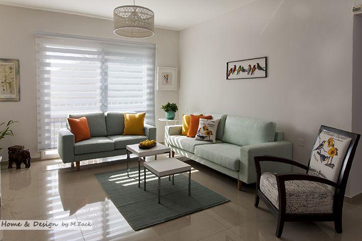 Sky blue sofa orange and yellow deco pillows soft shading in living room design m zack my - Deco room oranje ...