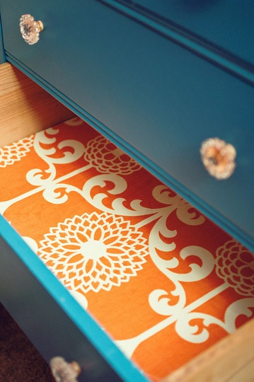 refinished dresser with cool drawer pulls and fabric-lined drawers