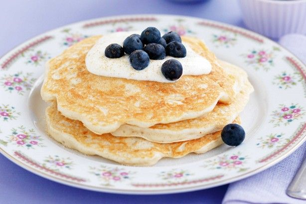 Delicious apple and cinnamon pancakes with yogurt and blueberries on top. Easy to make and a great breakfast or morning tea snack for the classroom.