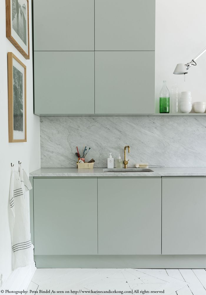 Loving the combo of light grey & marble...so stylish! Read about this beautiful Swedish flat with white wooden floors on www.karinecandicekong.com