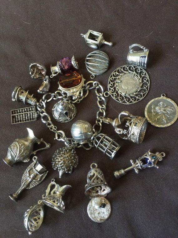 https://i.pinimg.com/736x/68/45/3e/68453e48afa2f3e0da6aff70497abc18--charm-braclets-silver-charm-bracelet.jpg