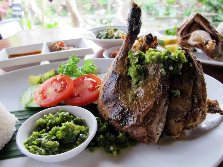 Bebek Bakar is a traditional roasted duck served with a puree sauce combining strong spices giving the duck a rich flavor once it's roasted. The texture of the meat is harder than chicken with a gamey taste or something like that. It's delicious…we guarantee it!