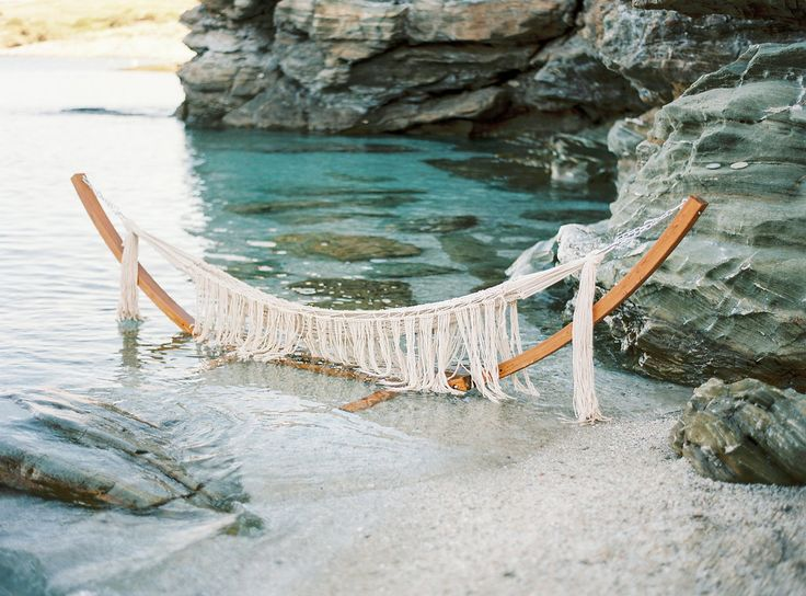 Want to Elope by the Sea? This is Where You Should Do It.  Photo by Thecablook Fotolab - Concept, planning & design by I Wish Chic Events - Macrame hammock by Boho choco