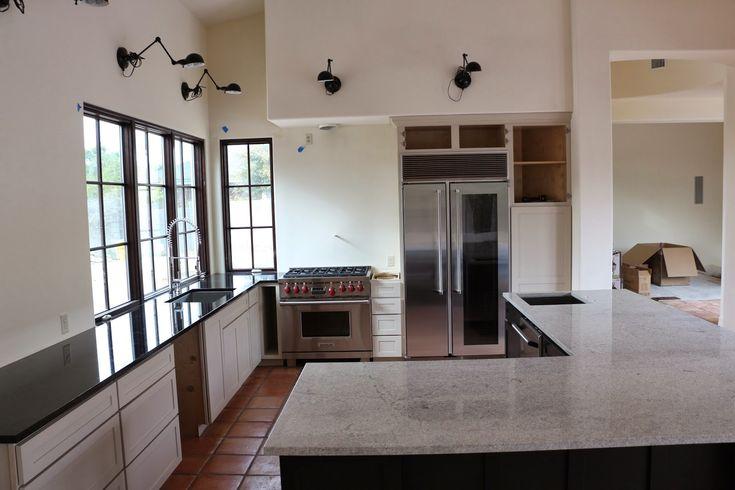 bianco montahna granite, black granite countertops, wolf range, marvel refrigerator, glass door refrigerator