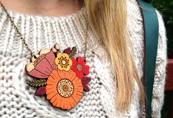 This hand-painted, laser-cut birch necklace is made by a graphic designer in the U.K. #etsyfinds