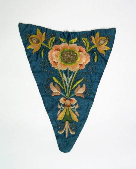 Stomacher, c. 1780. Blue silk embroidered with flowers in multicoloured silks.