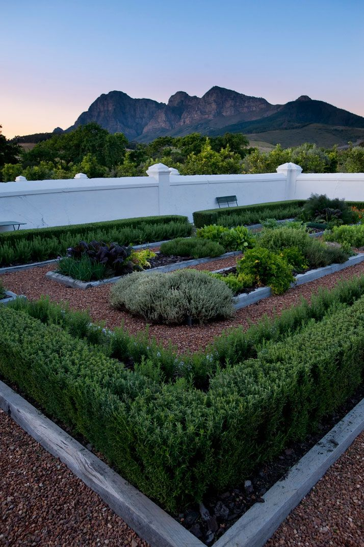 Walled kitchen garden in Babylonstoren, an exceptional country getaway, working farm and luxury hotel in South Africa. Photo courtesy of Babylonstoren via www.yatzer.com.
