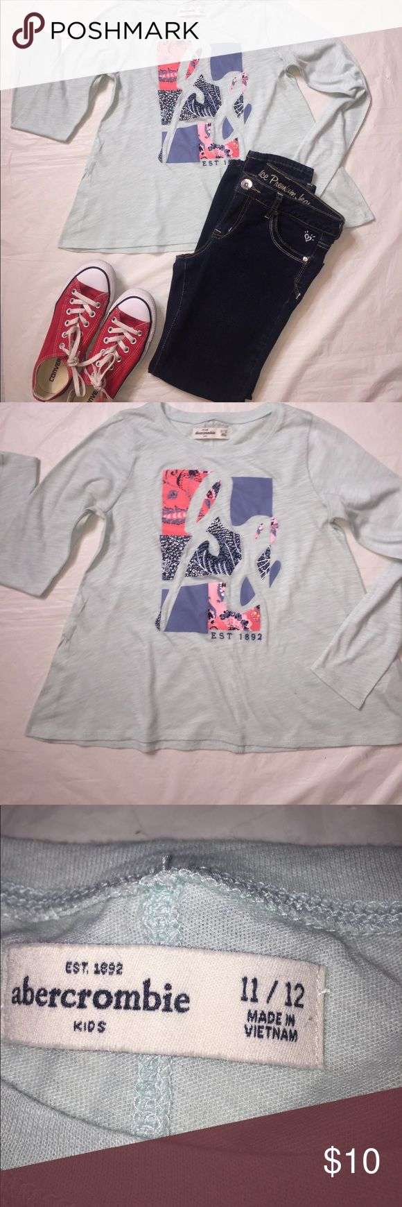 Abercrombie girls long sleeve tee Abercrombie girls long sleeve light blue tee in great condition.size 11-12 and sleeve 21 1/2 and length 20 Abercombie Kids Shirts & Tops Tees - Long Sleeve