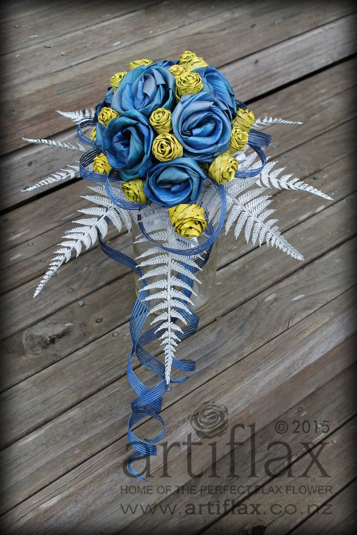 Blue full bloom flax flowers with yellow flax woven rose buds with silver fern and Hapene flax foliage bouquet by Artiflax
