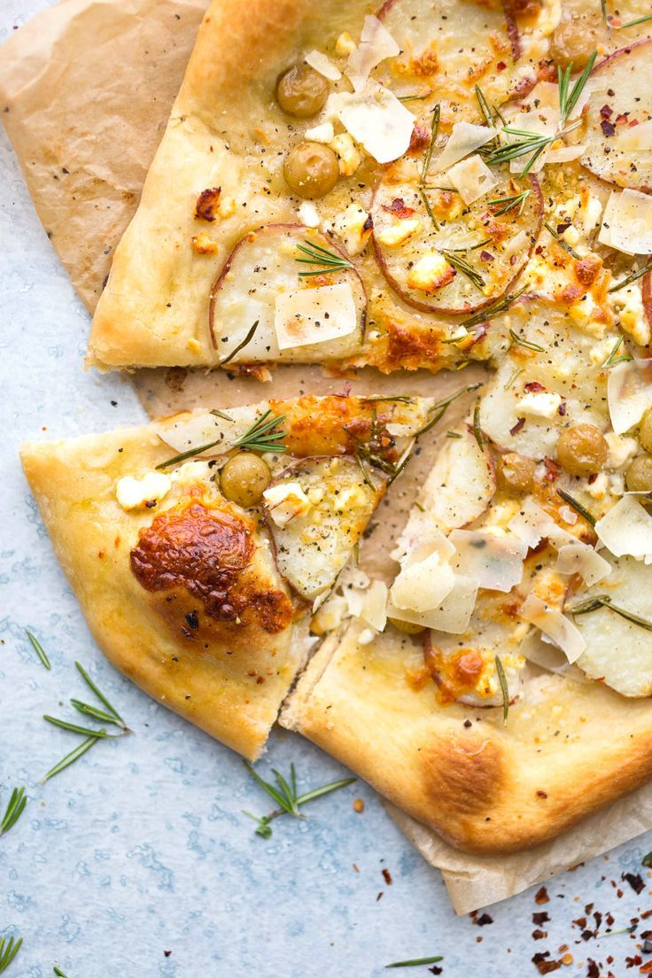 The BEST homemade veggie pizza ever! This Potato Grape and Rosemary Pizza hits all the notes with sweet honey, savory rosemary, and filling potatoes!