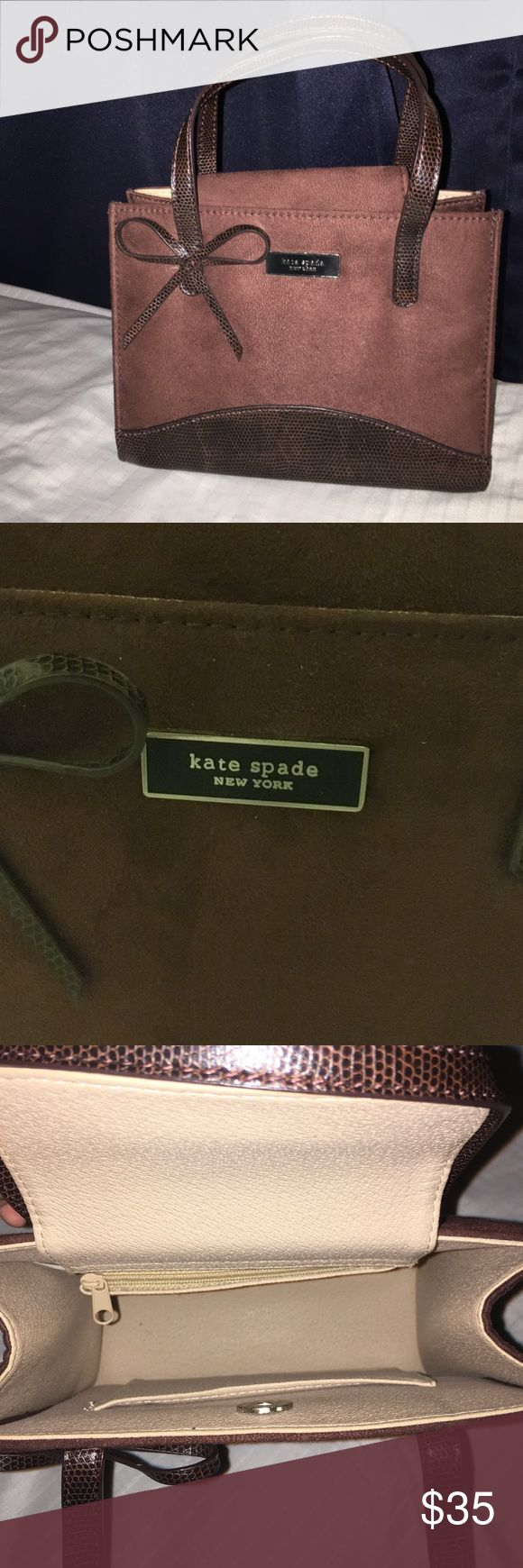Authentic Kate Spade New York mini satchel Mini Kate Spade satchel crafted in a chocolate suede with authentic flat handles plus bow at the bottom of the left handle. Bottom of satchel is brown leather with 4 silver metal pieces for stands. This Kate Spad features one interior zip pocket and one interior slip pockets. Magnetic closure. Used for decor in my room, never used. kate spade Bags Mini Bags