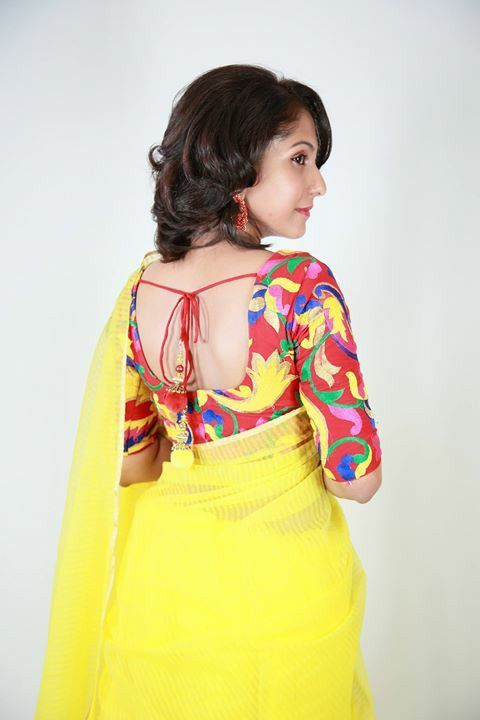 yellow cotton saree with contrast red thread work blouse