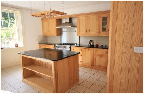 A used, solid oak, Mark Wilkinson Cooks kithcen.     The kitchen is 10 years old and is in superb condition - no damage to furniture, worktops or appliances - it has been well looked after. £8999