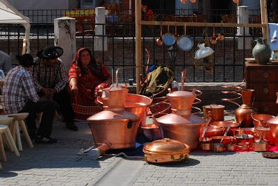 Image Emotions: Sibiu - the old city; Gipsies with crafted copper pots