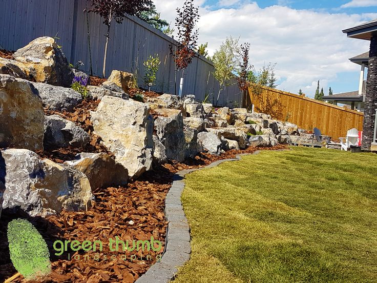 With an extreme elevation in your backyard, we can help you maximize your space with a nature-scaped boulder retaining wall. It's like coming home to the mountains in your backyard!