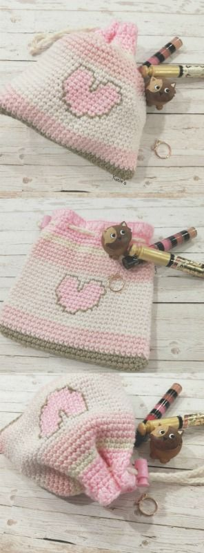 Crochet pink draw string bag Pink Love with a pink polka dot clasp add a tinge of cuteness.   Great for holding your essentials for a night out or putting items like keys, cards, cosmetics and trinkets!