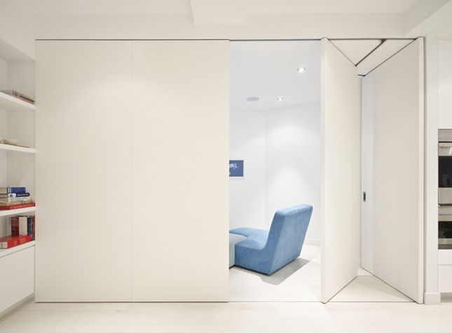 """Partition wall from Dwell. Genius! """"As they open, they fold and stack flush. There was no room for a pocket door since the oven is directly next to the partitioned-off space."""""""
