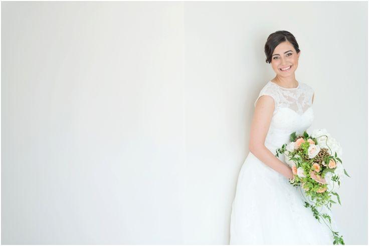 In my pronovias wedding dress and beautiful peach bouquet