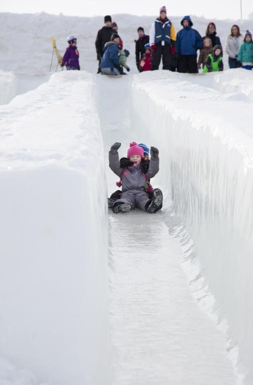 Ice slide at Snowflake Kingdom in Jacques-Cartier Park during Winterlude in Ottawa, Canada. For more information on Winterlude visit http://www.ottawatourism.ca/en/visitors/top-attractions/winterlude