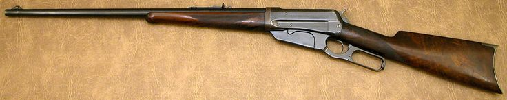 "Winchester 1895 Second Model Deluxe Takedown Rifle .405 WCF s/n 64796 mfg 1911  - 24"" round barrel, fancy checkered walnut stocks, case colored crescent buttplate. Barrel retains 80% original blue finish; receiver and lever retain 70% original bright blue starting to tone; crescent buttplate is silver; stocks retain about 60% - 70% of original varnish with checkering showing only some high-point wear; bore is shiny with sharp rifling."