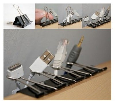 binder clips to organize cords!  We have one for our cell phone cord at our computer desk and it is so handy. just a reach away instead of being on the floor. :D