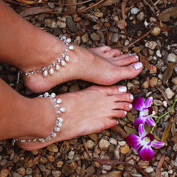 These gypsy style pearl & crystal anklets are the perfect statement accessory for the bohemian beach bride! Inspired by Morrocan Princess, this would be perfect for you to walk down the aisle of your beach destination wedding. Sold as a pair, these boho anklets are fun & versatile, can be worn many different ways. Can be worn barefoot or with heels. If your heels have detachable ankle straps, you can use these Khaleesi anklets as the straps instead. Join the two anklets together to wear as…