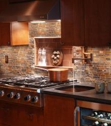 A chefs sink next to the cooktop with potfiller faucet
