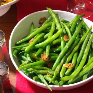Fresh Green Beans and Garlic - canola oil - butter - 4 garlic cloves - fresh green beans - reduced sodium chicken broth