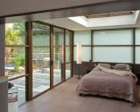 Une véranda Espace²Vie® par Grandeur Nature, la chambre