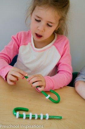 This Christmas activity is perfect for developing fine motor skills and counting.