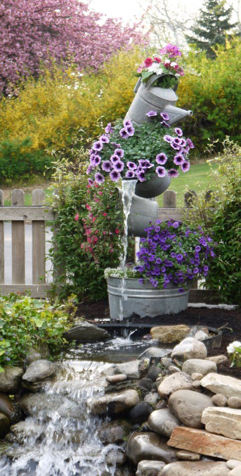 How to make a garden fountain using salvaged buckets watering cans soil plants - Water garden containers for sale ...