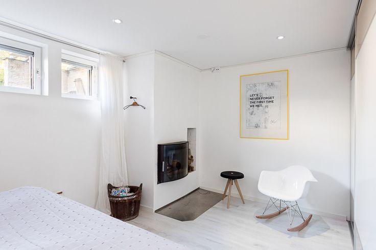 Bedesign print, white fireplace, bedroom design