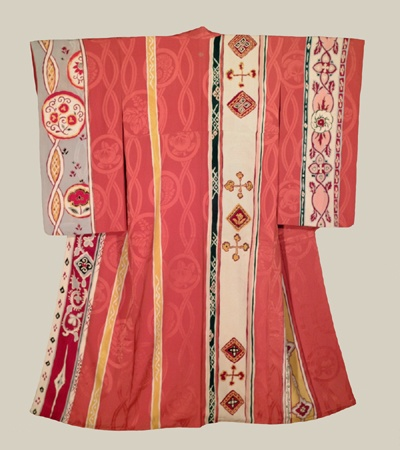 "Woven Kimono, Late Taisho to Early Showa era (1920-1940). A large silk kimono with unusual patterns: the base is rinzu, while some patterns are woven others are dyed. 51"" from sleeve-end to sleeve-end x 61"" height. The Kimono Gallery"