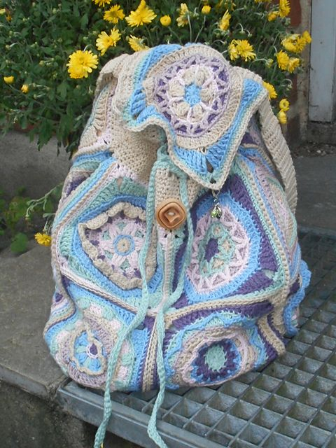 This is a backpack made from squares. The patterns for those are NOT included but can be found here: LillaBjorns Circles of the Sun CAL 2015