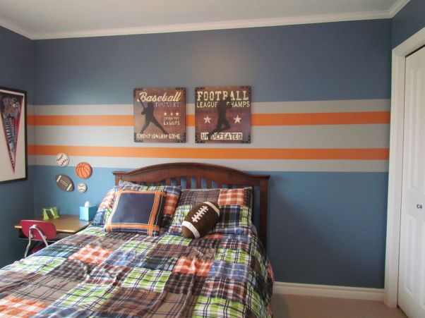 4 year old sons sport theme bedroom. , Blue walls with orange and gray stripes. Sports theme with football, basketball, hockey, and baseball.  , Boys Rooms Design