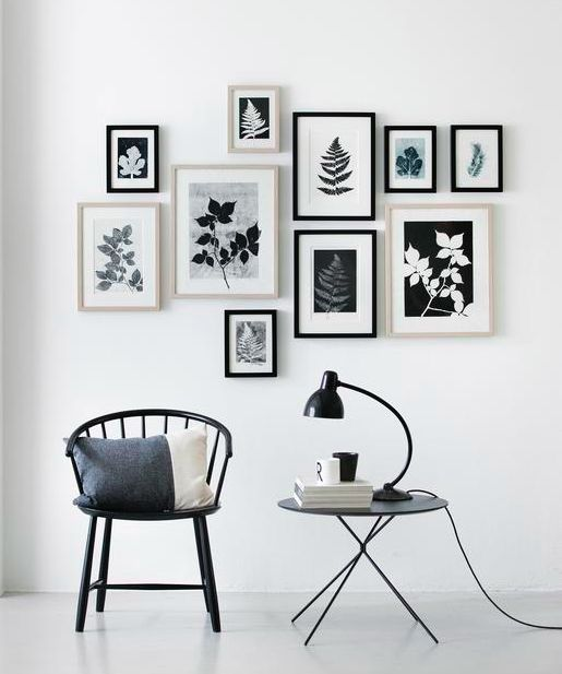 Decorate with black and white framed photos.