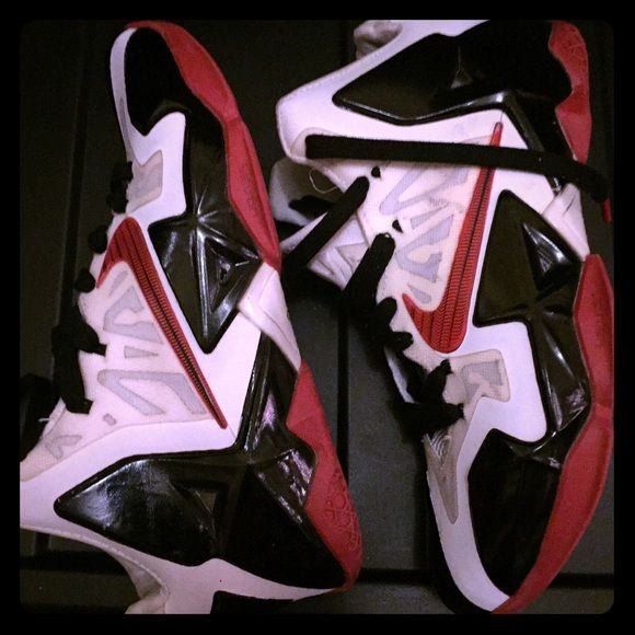 Nike Red & Black Lebrons (7.5-9.5) New Sneakers Red and black & white Jordan's  Lebrons by Nike. Hi top slick kicks, just don't fit me right. These are a new style & have been only worn a few times. Nike Shoes Sneakers