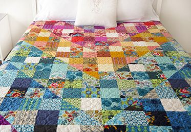 Color Dive Half-Square Triangle Quilt by Anna Maria Horner. Made with True Colors fabrics from the @FreeSpirit Fabric line.