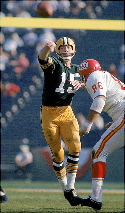 Bart Starr, Green Bay Packers throws a pass as Buck Buchanan of Kansas City Chiefs is in pursuit. Super Bowl I, Los Angeles, Jan. 15, 1967