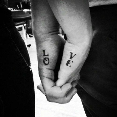 Love lettering couple tattoo
