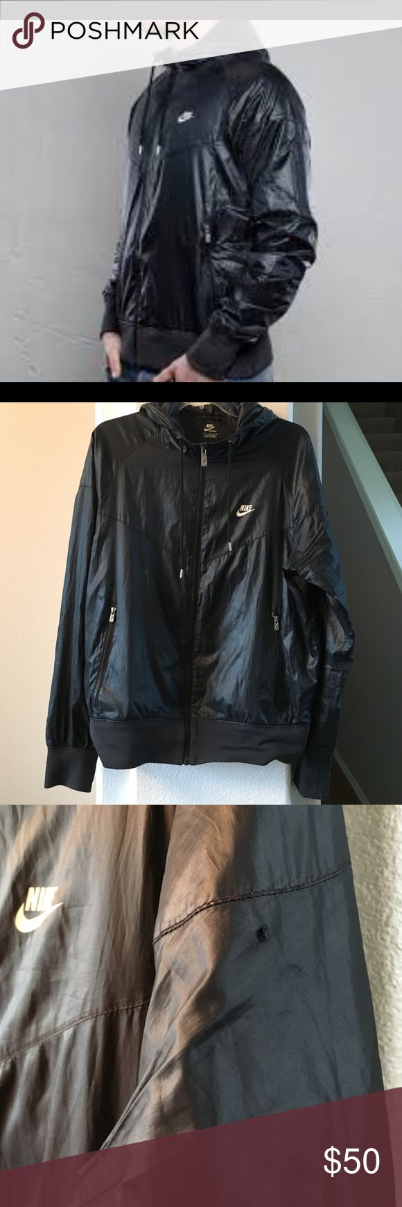 """New Listing! Men's Nike Windrunner Black Nike Windrunner! Water resistant shell- back ventilation- mesh lining- pockets- hoodie! Size medium. One little snag on left arm- see pic- otherwise great preowned condition! 22"""" across chest and 26"""" long. Nike Jackets & Coats Windbreakers"""
