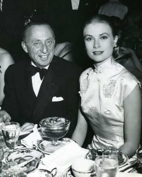 "gracie-bird:  ""Grace Kelly next to producer Joe Pasternak (Anchors Aweigh, The Merry Widow, Please-Don't Eat the Daisies) at the 13th Golden Globes, held February 23, 1956 at the Cocoanut Grove of the Ambassador Hotel in Los Angeles. That night she..."