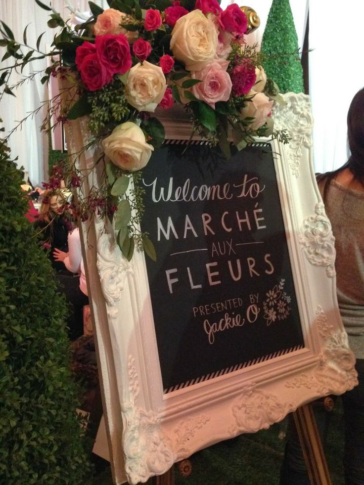 love the flower embellishment on this chalkboard sign at the Jackie O flower market at wed luxe show 2014 | springtime in Paris