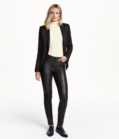 PREMIUM QUALITY. Leather pants with a regular waist, front pockets, and back pockets. Slim legs with seams at knees.