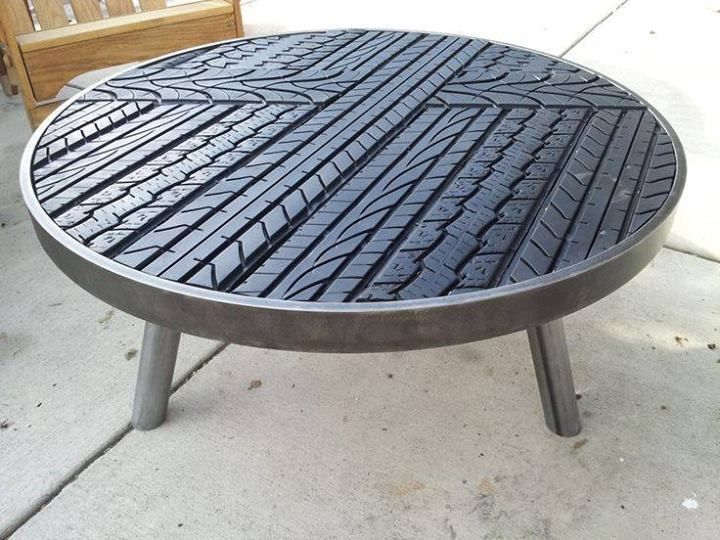tire table_ Would be cool as a bar table for a shop or man cave! Might be tough to clean up spills though. Maybe tires could be a wainscot trim or base moulding material.