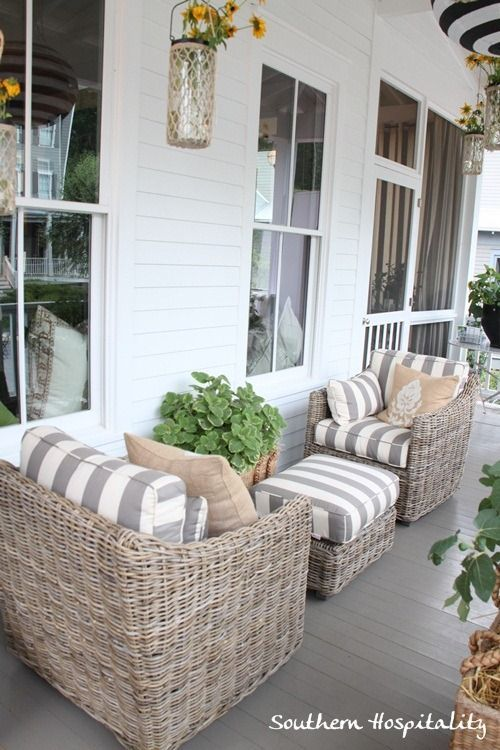 Love this combo of weathered wicker and grey/white stripes. Ballard House front porch